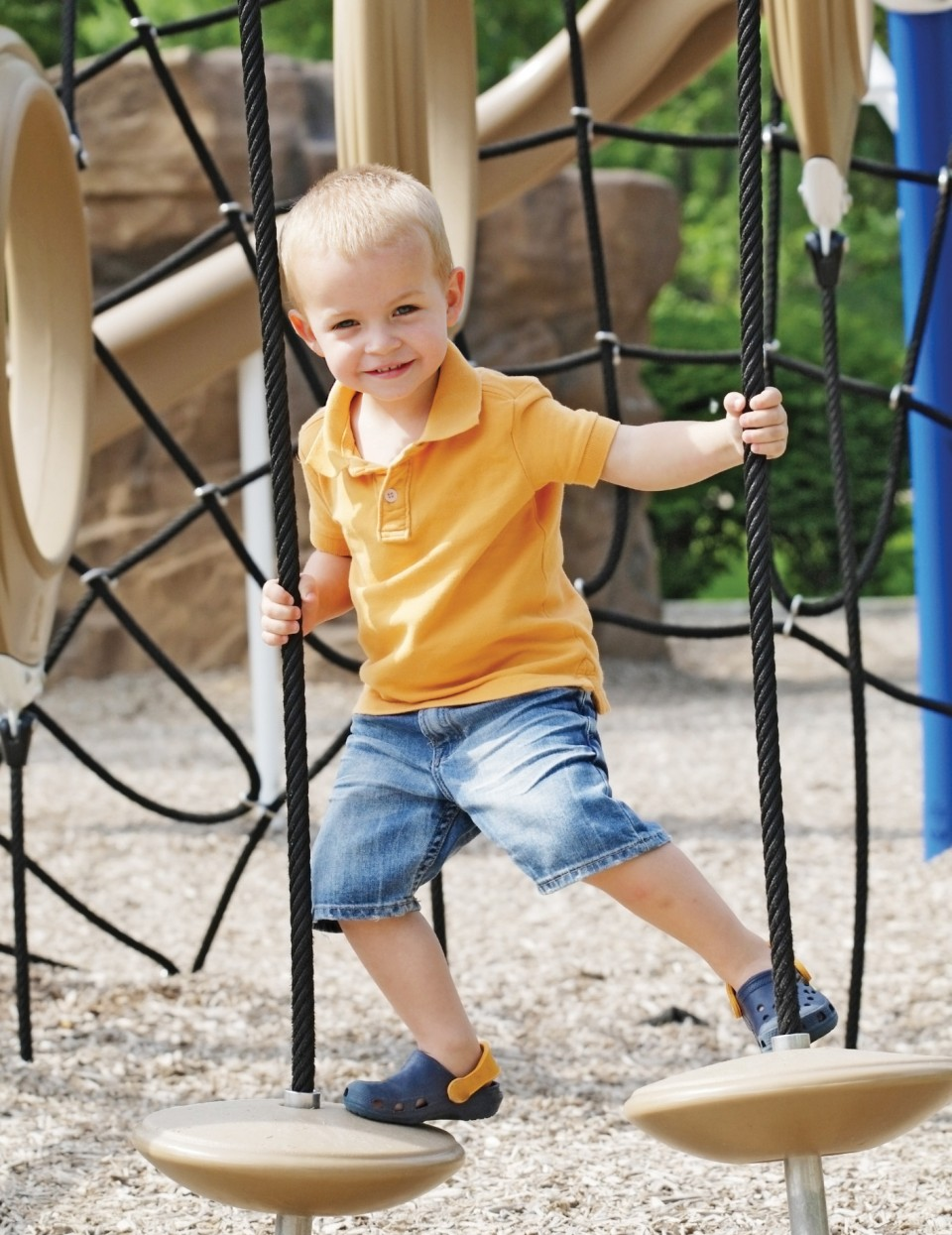 Image of child playing on obstacle course